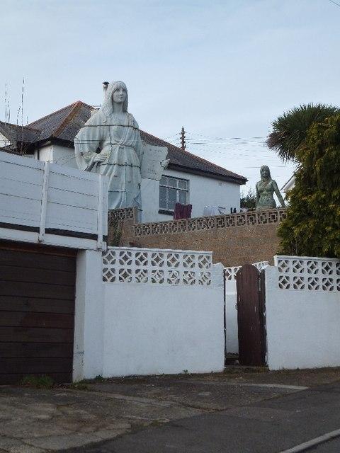 Statues in a garden in Mill Lane