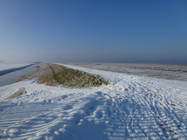 The Wash coast in winter - Snow on the sea bank and frost on the marsh