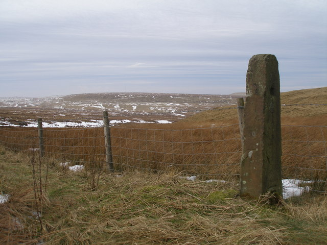 Cut benchmark on the gatepost at Fiddlers Green