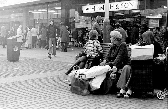 Shoppers outside W H Smith & Son