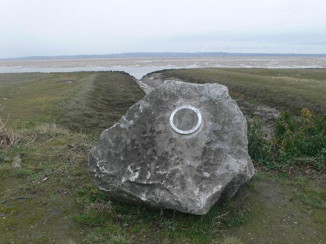 Community Link Plaque on a rock on the saltmarsh near Walwen
