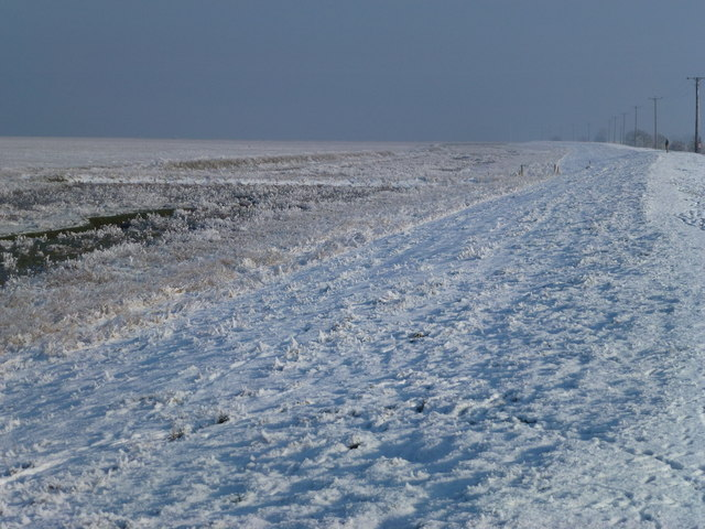 The Wash coast in winter - A solitary figure on the bank