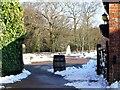 TQ3235 : Barrel and distant snowman, Tulley's Farm, Turners Hill by nick macneill