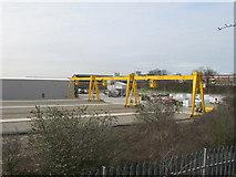 TQ2182 : New travelling crane at Crossrail depot by David Hawgood