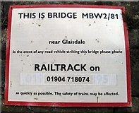 NZ7805 : Railway bridge ID sign by Mike Kirby