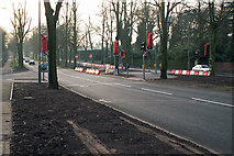 SP0583 : Traffic lights and new road junction for proposed science park, Bristol Road, Birmingham by Phil Champion