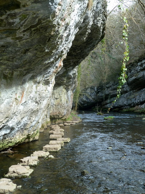 River, overhanging crag, and stepping stones