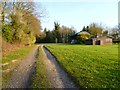 SU4437 : Track, shooting lodge and barn, Wonston by Andrew Smith