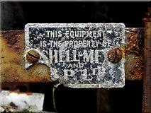 H6357 : Petrol pump tag by Kenneth  Allen