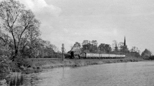 Down ECML stopping train approaching Offord & Buckden, seen across River Ouse