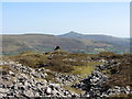 SO2223 : Abandoned quarries, cairn and Sugar Loaf in the distance by Gareth James