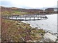 NR9269 : Fish cages at Portavadie by Oliver Dixon