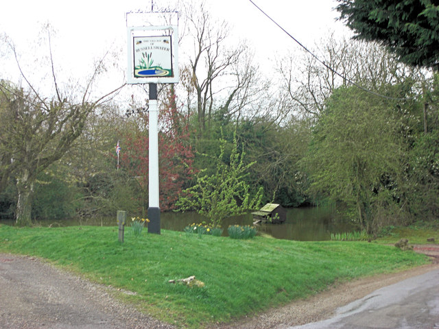 Pond and village sign at Russell's Water