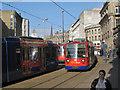 SK3587 : Trams, Fitzalan Square, morning rush hour by Robin Stott