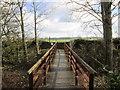 NZ0468 : The footbridge west of East Wallhouses by Ian S