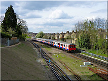 TQ2572 : Wimbledon train approaching Wimbledon Park station by Robin Webster