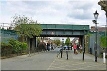 TQ2472 : Railway bridge at Wimbledon Park entrance by Robin Webster