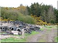 NZ1159 : Tyre dump off Lead Road by Christine Johnstone