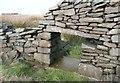 SE0710 : Sheep creep at Deer Hill Bents, Meltham by Humphrey Bolton