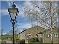 SE0753 : Ornate lamp and village hall by Pauline E