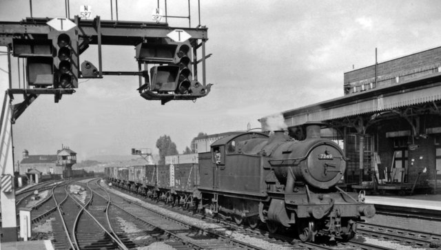 A 2-8-2T westbound entering Newport High Street with a Down train of condemned wagons