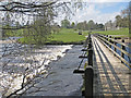 SE0754 : Weir and footbridge over the Wharfe by Pauline E