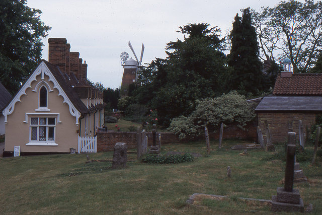 Thaxted: the almshouses and windmill from the churchyard