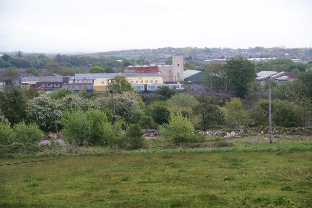 Metrolink tram as seen from Elton Reservoir