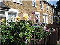 TQ4077 : Roses and bunting by Stephen Craven