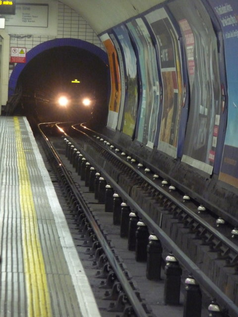 London: tube train approaching Leicester Square