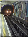 TQ2980 : London: tube train approaching Leicester Square by Chris Downer