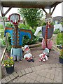 NT6177 : A scarecrow family at the Knowes Farm Shop garden by Walter Baxter