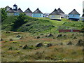 TG4919 : Winterton-on-Sea - Holiday homes and lighthouse by Richard Humphrey