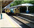 ST1876 : Two southbound trains waiting at Cardiff Queen Street railway station by Jaggery