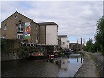 SE1437 : Canal wharf at Shipley by John Slater