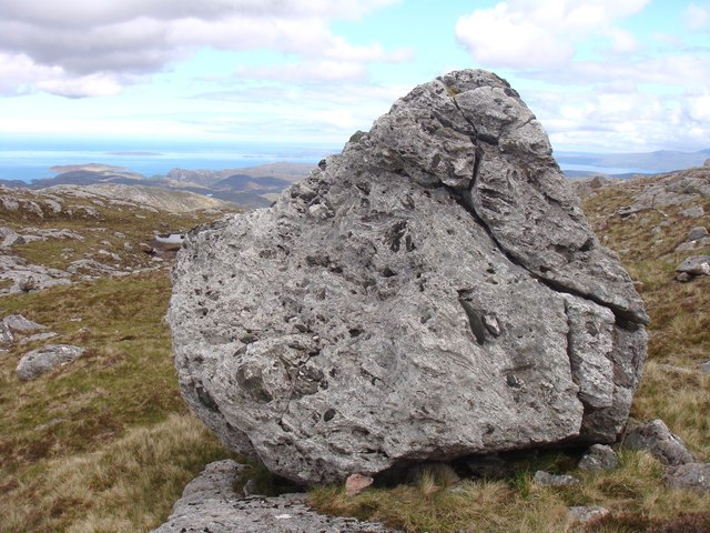 Gneiss boulder with ultrabasic pebbles