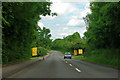 TQ0752 : Yellow signs on Epsom Road by Robin Webster