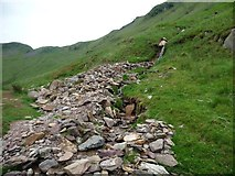 NY4116 : Redgate Gill's fallen stones along the footpath edge by Christine Johnstone