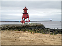 NZ3668 : Herd Groyne and Lighthouse by David Dixon