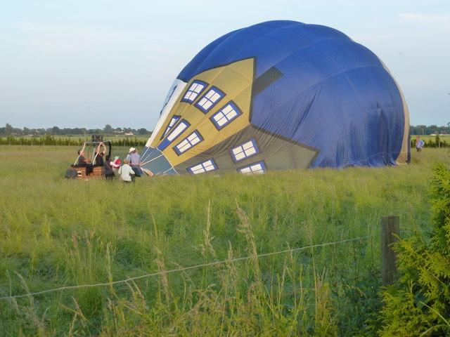 Hot air balloon in a grass field near March