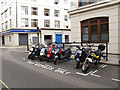 TQ2882 : Motorcycle parking by Stephen Craven