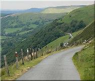 SH9124 : Narrow road descending into Cwm Cynllwyd by Mat Fascione