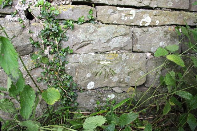 Benchmark on barn near 'Howraine'