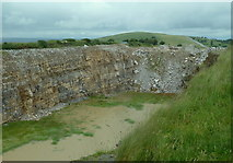 SK1973 : Old quarry by Longstone Edge by Andrew Hill