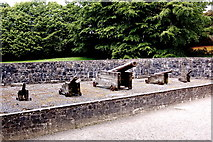 R4560 : Bunratty Castle - Courtyard - Array of 5 Cannon by Joseph Mischyshyn