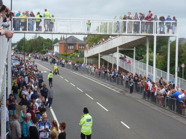 Ensbury Park: people line Boundary Lane ahead of the Olympic torch