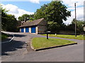 TL0893 : Grass covered road junction in Elton by Michael Trolove