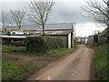 SX8553 : Farm buildings and a yacht near Downton Cross by Robin Stott
