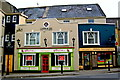 R3377 : Ennis - Wood Quay - Cahir & Co Solicitors, Giftvenue, Abbey Newsagency  by Joseph Mischyshyn