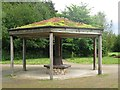 SK5374 : Wooden shelter with a living roof, Creswell Crags by Richard Green